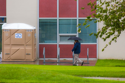 A number of consecutive rainy days brought out a variety of umbrellas on the Fairbanks campus in August 2015.  Filename: CAM-15-4627-11.jpg