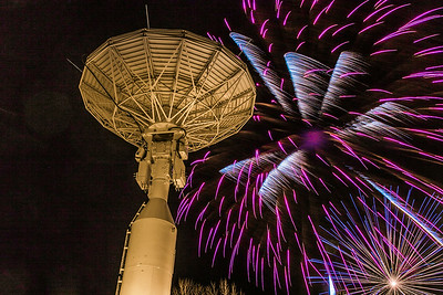 Fireworks explode near the Alaska Satellite Facility's new 11-meter antenna on West Ridge during the annual New Year's Eve Sparkatular event sponsored by local businesses.  Filename: CAM-13-4028-17.jpg