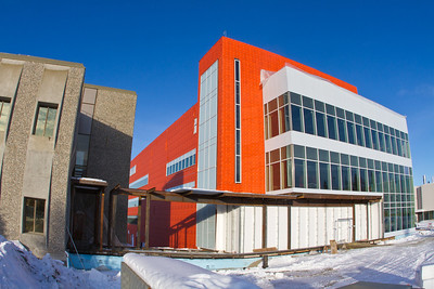 The new Life Sciences Facility takes shape next to the Irving Building on UAF's West Ridge.  Filename: CAM-12-3294-03.jpg