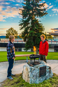 Ethan Berkeland, left, and Tristan Sayre discuss the day's events about 9 p.m. near the Naniq perpetual flame on Sunday, Aug. 30 on the Fairbanks campus.  Filename: CAM-15-4638-108.jpg