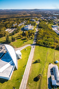 An aerial view above Yukon Drive on the UAF campus looking east toward Fairbanks at about 11:25 a.m. on Sept. 10, 2016.  Filename: CAM-16-4992-119.jpg
