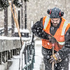 "Maintenance crew foreman Raif Kennedy works to clear a path in front of the Rasmuson Library during a brief but heavy snowfall Nov. 5 on the Fairbanks campus.  <div class=""ss-paypal-button"">Filename: CAM-13-3993-10-Edit.jpg</div><div class=""ss-paypal-button-end"" style=""""></div>"