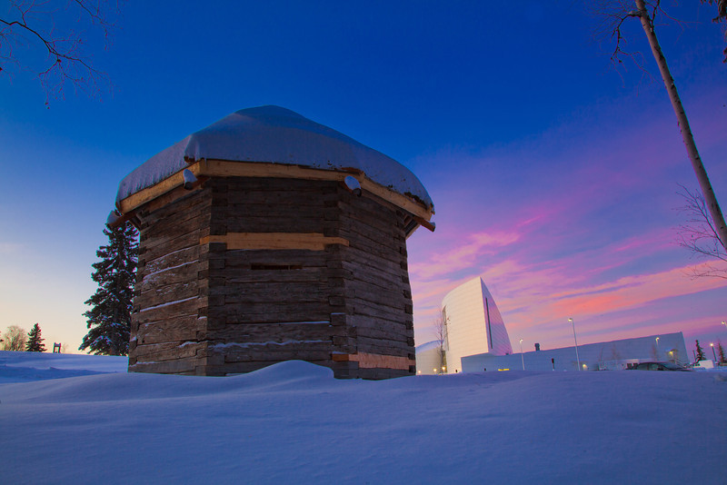 """The 19th century Russian blockhouse stands in stark contrast to the modern University of Alaska Museum of the North on the Fairbanks campus.  <div class=""""ss-paypal-button"""">Filename: CAM-12-3275-11.jpg</div><div class=""""ss-paypal-button-end"""" style=""""""""></div>"""