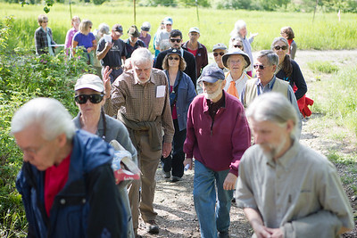 Attendees of the Les Viereck Nature Trail dedication ceremony walk to the entrance of the trail.  Filename: CAM-12-3435-10.jpg