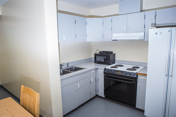 """Lathrop Hall has a capacity for up to 130 students with a large lounge on the ground floor, a laundry facility in the basement, and kitchens on the second and fifth floors.  <div class=""""ss-paypal-button"""">Filename: CAM-16-4941-97.jpg</div><div class=""""ss-paypal-button-end""""></div>"""
