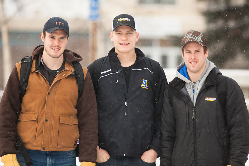 "Justin Tateson, left, Colton Parayko, and Adam Henderson pause for a photo at the cornerstone plaza after walking from the Bunnell Building at the first snowfall of the semester.  <div class=""ss-paypal-button"">Filename: CAM-12-3589-75.jpg</div><div class=""ss-paypal-button-end"" style=""""></div>"