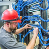 "An IT network specialist works on the communications infrastructure in the Murie Building a couple of months before it opens on UAF's West Ridge.  <div class=""ss-paypal-button"">Filename: CAM-13-3789-70.jpg</div><div class=""ss-paypal-button-end"" style=""""></div>"