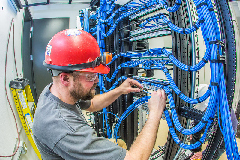 """An IT network specialist works on the communications infrastructure in the Murie Building a couple of months before it opens on UAF's West Ridge.  <div class=""""ss-paypal-button"""">Filename: CAM-13-3789-70.jpg</div><div class=""""ss-paypal-button-end"""" style=""""""""></div>"""