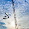 "A 220-foot crane lifts steel beems into position as workers complete the superstructure for the third floor of the new engineering facility in April 2014.  <div class=""ss-paypal-button"">Filename: CAM-14-4131-39.jpg</div><div class=""ss-paypal-button-end""></div>"