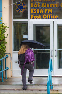 A number of consecutive rainy days brought out a variety of umbrellas on the Fairbanks campus in August 2015.  Filename: CAM-15-4627-29.jpg