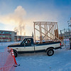 "Engineering students Rowland Powers (in pickup) and Andy Chamberlain unload pieces of the superstructure in preparation for laying ice and building the 2012 ice arch. The construction of an ice arch on campus has been a tradition among engineering majors at UAF for more than 50 years.  <div class=""ss-paypal-button"">Filename: CAM-12-3261-24.jpg</div><div class=""ss-paypal-button-end"" style=""""></div>"