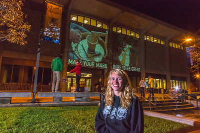 Undergraduate Teal Rogers poses during a late night promotional video shoot  by the Rasmuson Library.  Filename: CAM-13-3925-197.jpg