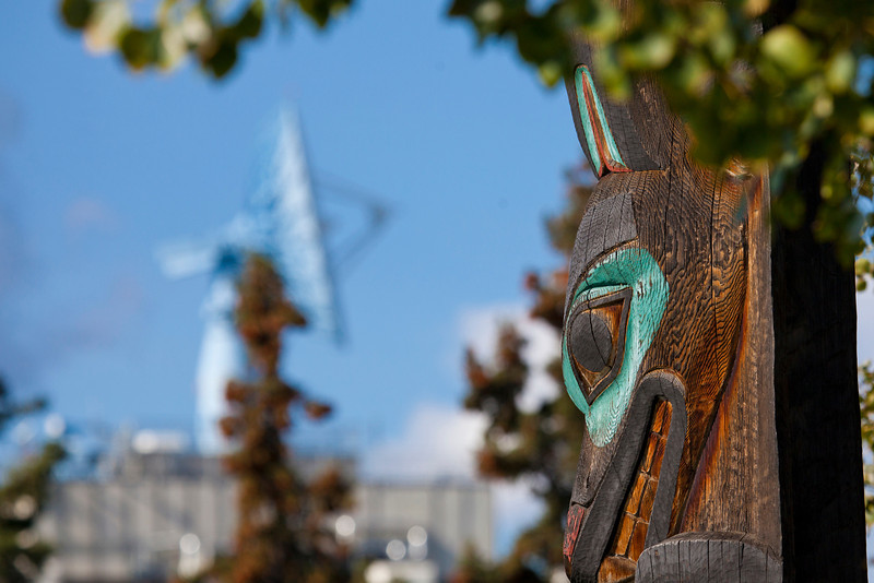 """The totem pole outside the University of Alaska Museum of the North stands in contrast to the satellite dish on top of the Elvey Building.  <div class=""""ss-paypal-button"""">Filename: CAM-10-2859-130.jpg</div><div class=""""ss-paypal-button-end"""" style=""""""""></div>"""