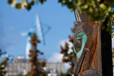 The totem pole outside the University of Alaska Museum of the North stands in contrast to the satellite dish on top of the Elvey Building.  Filename: CAM-10-2859-130.jpg