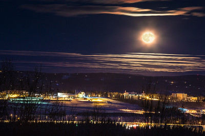 A full moon rises over the UAF campus in late December.  Filename: CAM-12-3686-comp.jpg