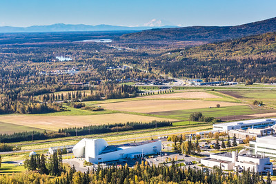 Denali is seen on the horizon behind the University of Alaska Museum of the North on the UAF campus in an aerial photograph taken about 11:20 on Sept. 10, 2016.  Filename: CAM-16-4992-088.jpg