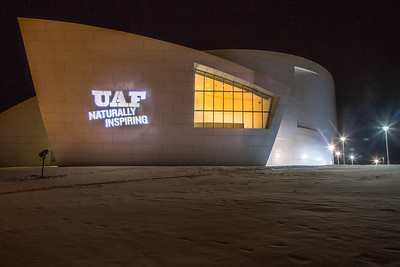 The branding tagline is projected onto the wall of the museum.  Filename: CAM-12-3636-12.jpg