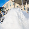 "A Facilities Services crew member uses some heavy equipment to sweep the sidewalk in front of Signers' Hall after a late winter snowfall.  <div class=""ss-paypal-button"">Filename: CAM-13-3786-21.jpg</div><div class=""ss-paypal-button-end"" style=""""></div>"
