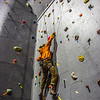 "A climber chooses his route during an evening event on UAF's climbing wall.  <div class=""ss-paypal-button"">Filename: CAM-13-3925-2.jpg</div><div class=""ss-paypal-button-end"" style=""""></div>"