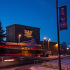 """The tagline """"Naturally Inspiring"""" is illuminated on the outside wall of UAF's Salisbury Theatre on a cold winter evening.  <div class=""""ss-paypal-button"""">Filename: CAM-12-3678-8.jpg</div><div class=""""ss-paypal-button-end"""" style=""""""""></div>"""