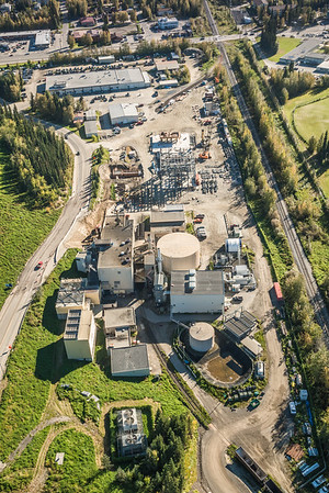 An aerial view of UAF's new combined heat and power plant being built adjacent to the existing unit that's been in service since the 1960s.  Filename: CAM-16-4992-064.jpg