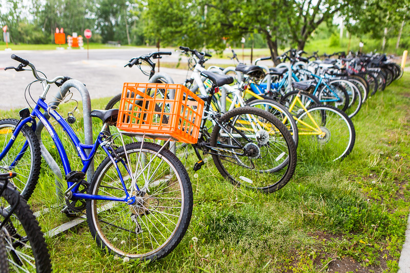 """A row of bicycles is seen in front of the Moore-Bartlett-Skarland building.  <div class=""""ss-paypal-button"""">Filename: CAM-16-4917-57.jpg</div><div class=""""ss-paypal-button-end""""></div>"""