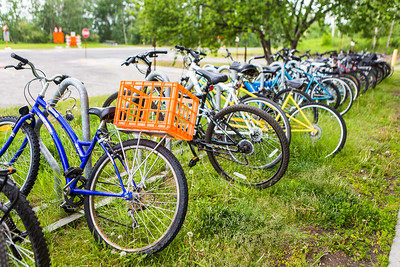 A row of bicycles is seen in front of the Moore-Bartlett-Skarland building.  Filename: CAM-16-4917-57.jpg