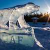 "The Nanook ice sculpture greets visitors to campus from its home near the kiosk along Thompson Drive.  <div class=""ss-paypal-button"">Filename: CAM-12-3327-08.jpg</div><div class=""ss-paypal-button-end"" style=""""></div>"