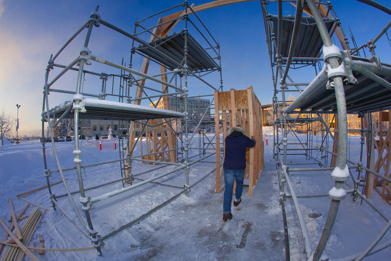 "Engineering major Rowland Powers helps position pieces of the superstructure in preparation for laying ice and building the 2012 ice arch. The construction of an ice arch on campus has been a tradition among engineering majors at UAF for more than 50 years.  <div class=""ss-paypal-button"">Filename: CAM-12-3261-32.jpg</div><div class=""ss-paypal-button-end"" style=""""></div>"