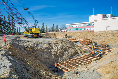 Construction work proceeds on the foundation of a major expansion of the Duckering Building on the Fairbanks campus. The addition will include much needed lab and classroom space for UAF's engineering programs.  Filename: CAM-13-3839-15.jpg