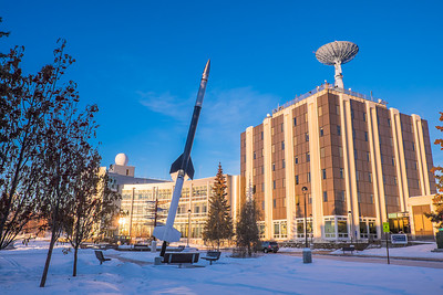 A mid-winter scene depicting the Akasofu Building which houses the International Arctic Research Station, and the Elvey Building, home to UAF's Geophysical Institute.  Filename: CAM-15-4428-03.jpg
