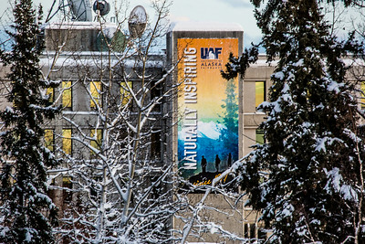 A large banner hangs from the Gruening Building fire escape on the Fairbanks campus.  Filename: CAM-14-4039-84.jpg