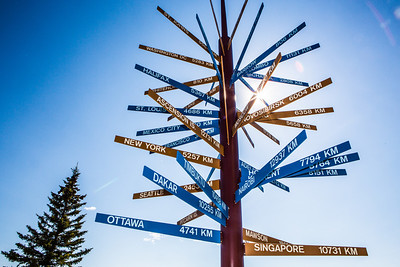 The milepost sign in front of UAF's Gephysical Institute serves as a local landmark.  Filename: CAM-12-3414-06.jpg