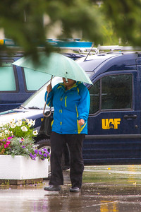 A number of consecutive rainy days brought out a variety of umbrellas on the Fairbanks campus in August 2015.  Filename: CAM-15-4627-102.jpg