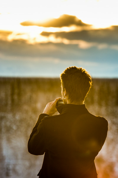 "A student pauses to snap a photo of a January sunset on the Fairbanks campus.  <div class=""ss-paypal-button"">Filename: CAM-14-4039-83.jpg</div><div class=""ss-paypal-button-end""></div>"