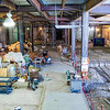 """An employee with one of several contractors working with UAF makes progress on the ground floor of the new Life Sciences Facility.  <div class=""""ss-paypal-button"""">Filename: CAM-12-3357-01.jpg</div><div class=""""ss-paypal-button-end"""" style=""""""""></div>"""