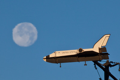 A model space shuttle atop the Atkinson Building rotates on its axis in front of a full moon.  Filename: CAM-10-2888-02.jpg