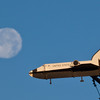 """A model space shuttle atop the Atkinson Building rotates on its axis in front of a full moon.  <div class=""""ss-paypal-button"""">Filename: CAM-10-2888-02.jpg</div><div class=""""ss-paypal-button-end"""" style=""""""""></div>"""