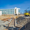 """Construction work proceeds on the foundation of a major expansion of the Duckering Building on the Fairbanks campus. The addition will include much needed lab and classroom space for UAF's engineering programs.  <div class=""""ss-paypal-button"""">Filename: CAM-13-3839-25.jpg</div><div class=""""ss-paypal-button-end"""" style=""""""""></div>"""