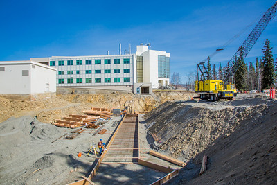 Construction work proceeds on the foundation of a major expansion of the Duckering Building on the Fairbanks campus. The addition will include much needed lab and classroom space for UAF's engineering programs.  Filename: CAM-13-3839-25.jpg