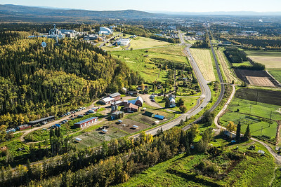 An aerial view of UAF looking east toward Fairbanks at about 11:15 a.m. on Sept. 10, 2016. The experiment farm operated by the School of Natural Resources and Extension is featured in the lower center of this photo.  Filename: CAM-16-4992-006.jpg