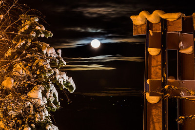 A full moon rises over the UAF campus in late December.  Filename: CAM-12-3686-20.jpg