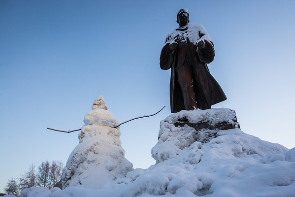 """A snowman stands next to the statue of Charles Bunnell at the Cornerstone Plaza on campus.  <div class=""""ss-paypal-button"""">Filename: CAM-13-4036-19.jpg</div><div class=""""ss-paypal-button-end""""></div>"""