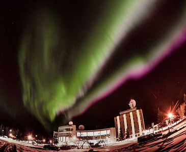 The aurora borealis dances across the night sky above the International Arctic Center Research and the Elvey Building on UAF's West Ridge.  Filename: CAM-12-3324-20.jpg