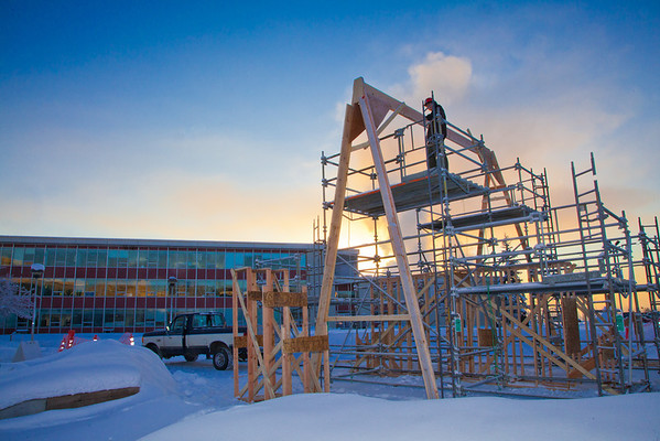 """Engineering majors Steve Lee, stands on the  scaffolding in preparation for construction of the 2012 ice arch going up in Cornerstone Plaza.  <div class=""""ss-paypal-button"""">Filename: CAM-12-3261-55.jpg</div><div class=""""ss-paypal-button-end"""" style=""""""""></div>"""