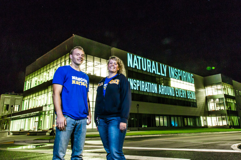 "Undergraduates Gavin Meggert and Iris Fletcher pose during a late night promotional video shoot  by the Murie Building on UAF's West Ridge.  <div class=""ss-paypal-button"">Filename: CAM-13-3925-211.jpg</div><div class=""ss-paypal-button-end"" style=""""></div>"