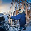 "Engineering students Andy Chamberlain (left) and Rowland Powers unload pieces of the superstructure in preparation for laying ice and building the 2012 ice arch. The construction of an ice arch on campus has been a tradition among engineering majors at UAF for more than 50 years.  <div class=""ss-paypal-button"">Filename: CAM-12-3261-29.jpg</div><div class=""ss-paypal-button-end"" style=""""></div>"