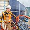 "Jeff Montgomery with Industrial Electric works on connecting new solar panels on the SRC into the building's electrical system.  <div class=""ss-paypal-button"">Filename: CAM-12-3568-17.jpg</div><div class=""ss-paypal-button-end"" style=""""></div>"