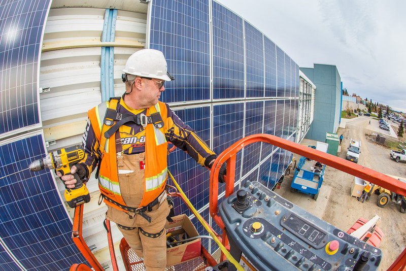 """Jeff Montgomery with Industrial Electric works on connecting new solar panels on the SRC into the building's electrical system.  <div class=""""ss-paypal-button"""">Filename: CAM-12-3568-17.jpg</div><div class=""""ss-paypal-button-end"""" style=""""""""></div>"""