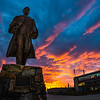 "A dramatic sunrise lights up the sky behind the statue of Charles Bunnell on a late October morning.  <div class=""ss-paypal-button"">Filename: CAM-13-3976-9.jpg</div><div class=""ss-paypal-button-end"" style=""""></div>"